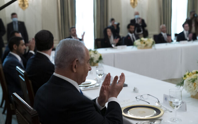 Israeli Prime Minister Benjamin Netanyahu applauds before a lunch in the State Dining Room of the White House after a signing ceremony for the Abraham Accords on the South Lawn of the White House, Tuesday, Sept. 15, 2020, in Washington. (AP/Alex Brandon)