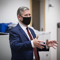 Britain's Labour Party leader Keir Starmer visits the Clinical Research Facility, a joint facility with NHS Lothian, at the University of Edinburgh School of Medicine, Edinburgh, Scotland, Thursday Sept. 17, 2020. (Jane Barlow/PA via AP)