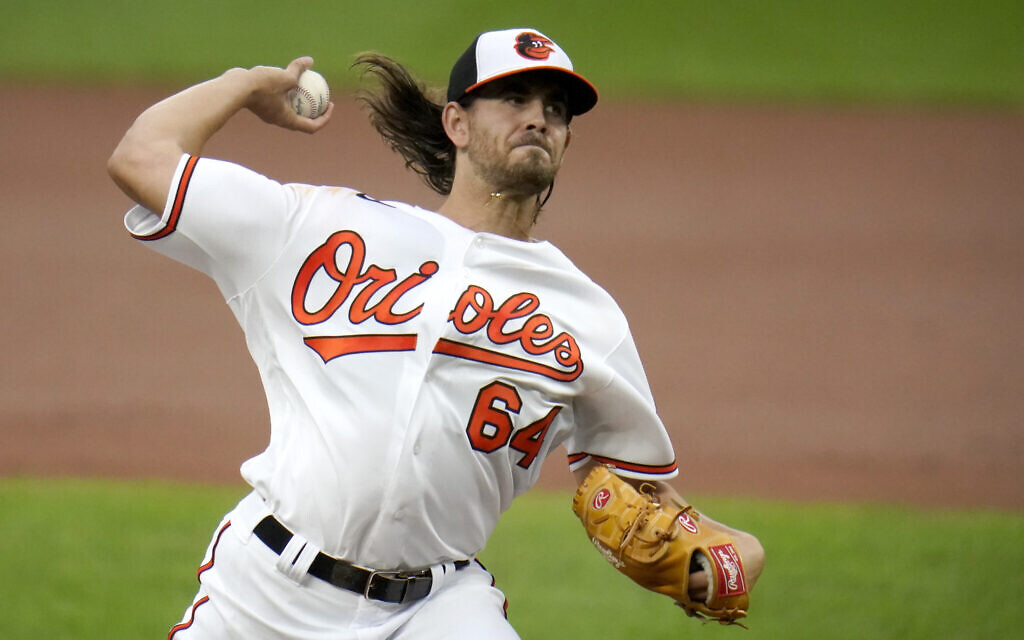 Baltimore Orioles starting pitcher Dean Kremer throws a pitch to the Tampa Bay Rays during the second inning of a baseball game, Thursday, Sept. 17, 2020, in Baltimore. (AP Photo/Julio Cortez)