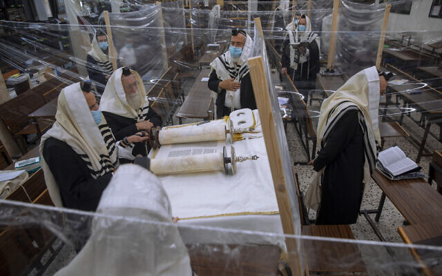 Ultra-Orthodox Jews during morning prayer in a synagogue during a nationwide three-week lockdown to curb the spread of the coronavirus, in Bnei Brak, Sept 21, 2020. (AP Photo/Oded Balilty)
