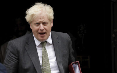 British Prime Minister Boris Johnson leaves 10 Downing Street in London, to attend the weekly Prime Minister's Questions at the Houses of Parliament, in London, Sept. 23, 2020 (AP Photo/Matt Dunham)