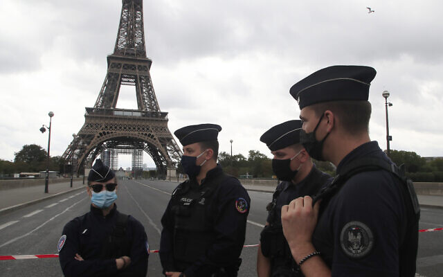 French police officers secure the bridge leading to the Eiffel Tower, September 23, 2020 in Paris. (AP Photo/Michel Euler)