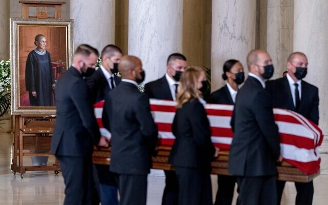 The flag-draped casket of Justice Ruth Bader Ginsburg, carried by Supreme Court police officers, arrives in the Great Hall at the Supreme Court in Washington, September 23, 2020. (AP Photo/Andrew Harnik, Pool)