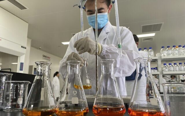 A worker inside a lab at the SinoVac vaccine factory in Beijing on September 24, 2020. (AP/Ng Han Guan)