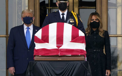 US President Donald Trump and US first lady Melania Trump pay respects as Justice Ruth Bader Ginsburg lies in repose at the Supreme Court building, September 24, 2020, in Washington. (AP Photo/J. Scott Applewhite)