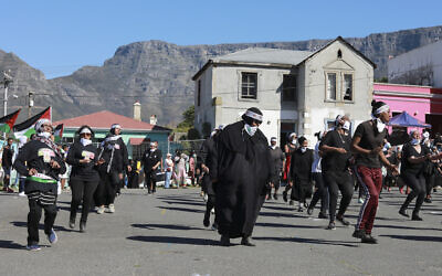 People dance to Jerusalema in Cape Town, South Africa, Sept. 24, 2020 (AP Photo/Nardus Engelbrecht)