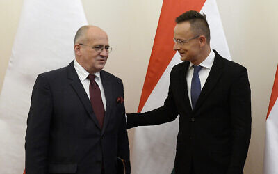 Hungarian Minister of Foreign Affairs and Trade Peter Szijjarto, right, welcomes his Polish counterpart, Zbigniew Rau in the Ministry of Foreign Affairs and Trade in Budapest, Hungary, Monday, September 28, 2020. (Lajos Soos/MTI via AP)