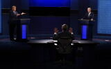 Moderator Chris Wallace of Fox News, center, gesturing during the first presidential debate between President Donald Trump, left, and Democratic presidential candidate former Vice President Joe Biden, right, Tuesday, Sept. 29, 2020, at Case Western University and Cleveland Clinic, in Cleveland, Ohio. (AP/Patrick Semansky)
