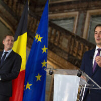 Belgian Minister of Cooperation Development and Finance, Alexander De Croo, right, and Belgian francophone Socialist Party chairman, Paul Magnette attend a media conference at the Egmont Palace in Brussels, Wednesday, Sept. 30, 2020. Almost 500 days after Belgian parliamentary elections, seven parties from both sides of the linguistic border have agreed on forming a fully functioning majority government that will center on dealing with the pandemic and its devastating economic impact. (AP Photo/Virginia Mayo)