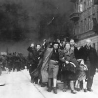 A group of Polish Jews are led away for deportation by German SS soldiers, in April/May 1943, during the destruction of the Warsaw Ghetto by German troops after an uprising in the Jewish quarter, 1943. (AP Photo)