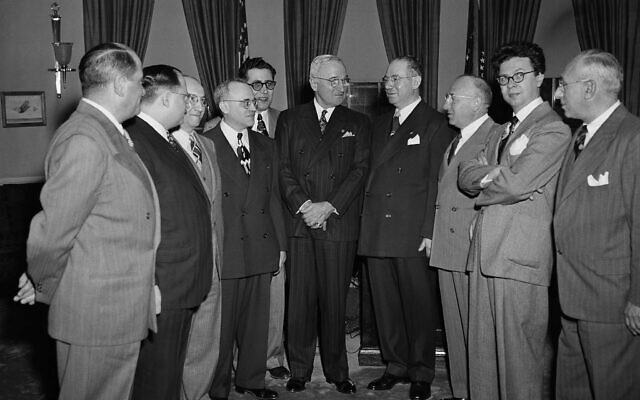 President Harry Truman poses with a committee from the American Association of English-Jewish newspapers in Washington, on Feb. 21, 1949 including fourth from right, Dr. Alexander Brin of the Boston Jewish Advocate (AP Photo/Henry Griffin)