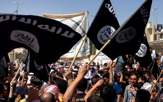 Demonstrators chant pro-Islamic State group slogans as they wave the group's flags in front of the provincial government headquarters in Mosul, Iraq, June 16, 2014. (AP Photo, File)