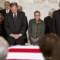 FILE: Supreme Court Justices, from left, Elena Kagan, Samuel Anthony Alito, Jr., Ruth Bader Ginsburg, and Anthony Kennedy participate in prayers at a private ceremony in the Great Hall of the Supreme Court in Washington, Friday, Feb. 19, 2016, where late Supreme Court Justice Antonin Scalia lies in repose. (AP Photo/Jacquelyn Martin, Pool)