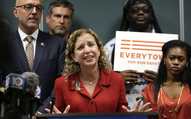 US Congresswoman Debbie Wasserman Schultz speaks during a news conference with Congressman Ted Deutch (L) looking on in Fort Lauderdale, Florida on July 5, 2016, (AP/Lynne Sladky)