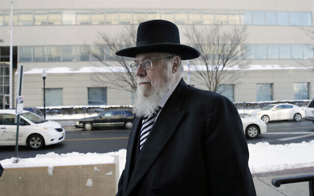 In a Wednesday, Feb. 18, 2015 file photo, Rabbi Mendel Epstein, right, arrives for his trial at federal court in Trenton, New Jersey (AP Photo/Mel Evans)