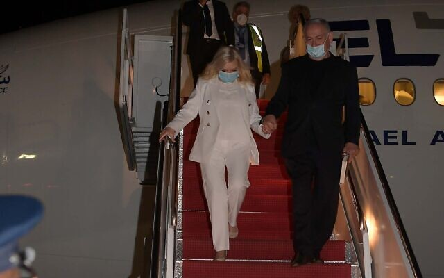 Prime Minister Benjamin Netanyahu and his wife Sara get off the plane at Andrews Air Force Base near Washington, DC, early on September 14, 2020, to sign normalization agreements at a White House ceremony with the United Arab Emirates and Bahrain. (Avi Ohayon / GPO)
