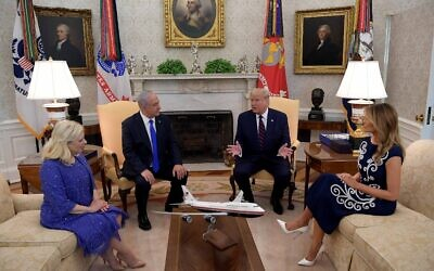 US President Donald Trump, with Melania Trump, hosts Prime Minister Benjamin Netanyahu and Sara Netanyahu in the Oval Office of the White House in Washington, DC, September 15, 2020 (SAUL LOEB / AFP)