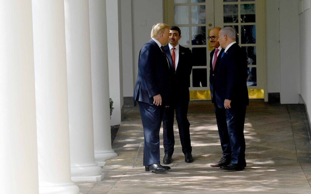 From left: US President Donald Trump, United Arab Emirates Foreign Minister Abdullah bin Zayed al-Nahyan, Bahrain Foreign Minister Abdullatif bin Rashid Alzayani, and Israel's Prime Minister Benjamin Netanyahu talk at the White House at the ceremony for the signing of the Abraham Accords between them, September 15, 2020 (Avi Ohayon/GPO )