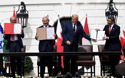 (L-R) Bahrain Foreign Minister Abdullatif al-Zayani, Israeli Prime Minister Benjamin Netanyahu, US President Donald Trump, and UAE Foreign Minister Abdullah bin Zayed Al-Nahyan hold up the documents they signed at the Abraham Accords ceremony where Bahrain and the United Arab Emirates recognized Israel, at the White House in Washington, DC, September 15, 2020. (Avi Ohayon / GPO)
