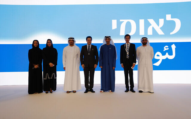 Bank Leumi's chairman Samer Haj Yehia, fourth from left, High Excellency Thani bin Ahmed Al Zeyoudi, the UAE Minister of State for Foreign Trade, fifth from left, and CEO Hanan Friedman, second from right, with UAE officials; Sept. 14, 2020 (Courtesy)