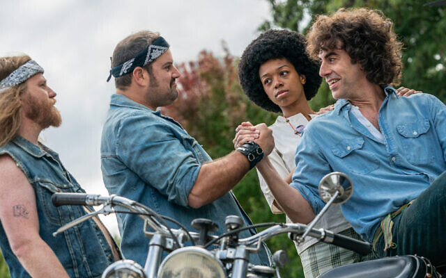 "Sasha Baron Cohen, right, as Abbie Hoffman in ""The Trial of the Chicago 7."" (Niko Tavernise/Netflix via JTA)"