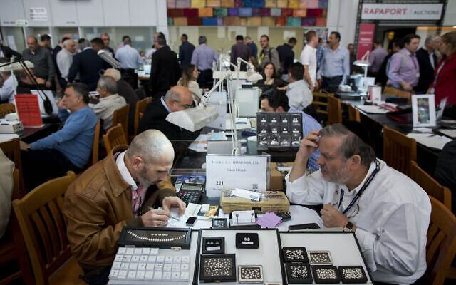 Illustrative: People trade during the International Diamond Week at the Israel Diamond Exchange center in Ramat Gan, Feburary 10, 2015 (Yonatan Sindel/Flash90)