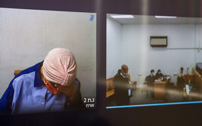 Malka Leifer seen on a screen, left, via a video link during a court hearing at the Jerusalem District Court on July 20, 2020. (Yonatan Sindel/Flash90)