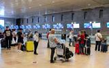 Passengers waiting to board a flight at Ben Gurion Airport near Tel Aviv on August 13, 2020. (Flash90)