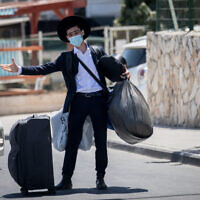 Illustrative photo: A student moving into the Hebron Yeshiva in Jerusalem on August 18, 2020. (Yonatan Sindel/Flash90)