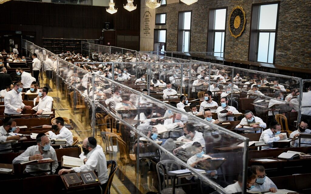 Ultra-Orthodox Jewish men study Torah in small 'capsule' groups at the Ateret Shlomo Yeshiva in the city of Modiin Illit, August 24, 2020. (Yossi Zeliger/Flash90)