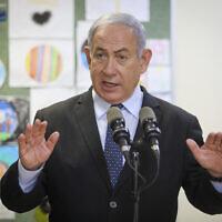 Prime Minister Benjamin Netanyahu at a school in Jerusalem, ahead of the opening of the school year, August 25, 2020. (Marc Israel Sellem/Pool/AFP)