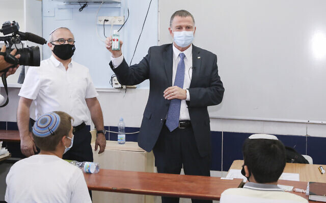 Health Minister Yuli Edelstein visits students on the first day of school at Orot Etzion school in Efrat on September 01, 2020 (Gershon Elinson/Flash90)