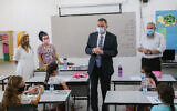 Health Minister Yuli Edelstein, center, visits students on the first day of school at Chen Nerya school in Alon Shvut, on September 1, 2020. (Gershon Elinson/Flash90)
