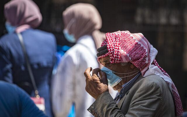 Jerusalem residents walk in the Old City on September 02, 2020. (Olivier Fitoussi/Flash90)