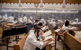 Yeshiva students study in separation capsules in Jerusalem on September 2, 2020. (Yonatan Sindel/Flash90)