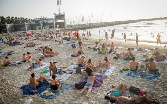 Israelis enjoy the hot weather at the beach in Tel Aviv, September 5, 2020. (Miriam Alster/FLASH90)