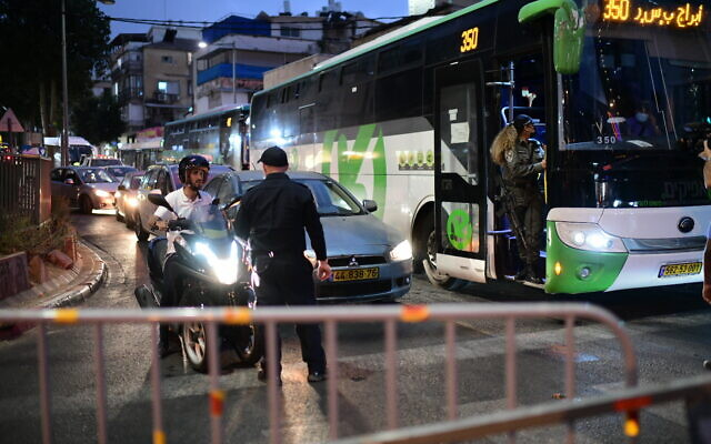 Police seen at the entrance to the ultra-Orthodox city of Bnei Brak as Israel enforces a night curfew, applied to some 40 cities all over country which have been badly infected with the coronavirus, September 8, 2020. (Tomer Neuberg/FLASH90)
