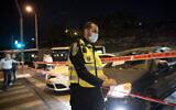 Police seen at the entrance to the neighborhood of Ramot in Jerusalem as Israel began enforcing a nightly curfew, September 8, 2020 (Yonatan Sindel/Flash90)