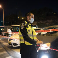 Police seen at the entrance to the neighborhood of Ramot in Jerusalem as Israel began enforcing a nightly curfew, September 8, 2020 (Yonatan Sindel/Flash90)