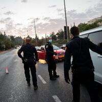Police at the entrance to the neighborhood of Ramot in Jerusalem on September 9, 2020. (Yonatan Sindel/Flash90)