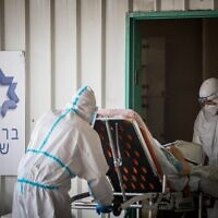 Magen David Adom workers wearing protective clothing outside the coronavirus unit at Shaare Zedek hospital in Jerusalem on September 10, 2020. (Yonatan Sindel/Flash90)