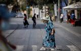 People walk with face masks on Jaffa street in Jerusalem on September 10, 2020. (Yonatan Sindel/Flash90)