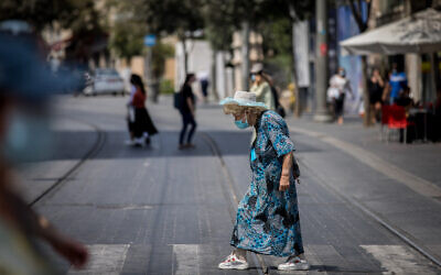People walk with face masks on Jaffa street in Jerusalem on September 10, 2020. (Yonatan Sindel/Flash90)