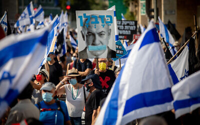 Israelis protest against Prime Minister Benjamin Netanyahu as they march in Jerusalem to his official residence, September 11, 2020. (Yonatan Sindel/Flash90)