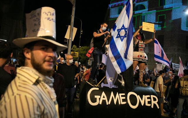 FILE: Israelis protest against Israeli prime minister Benjamin Netanyahu outside the PM's official residence in Jerusalem, on September 12, 2020. (Olivier Fitoussi/Flash90)