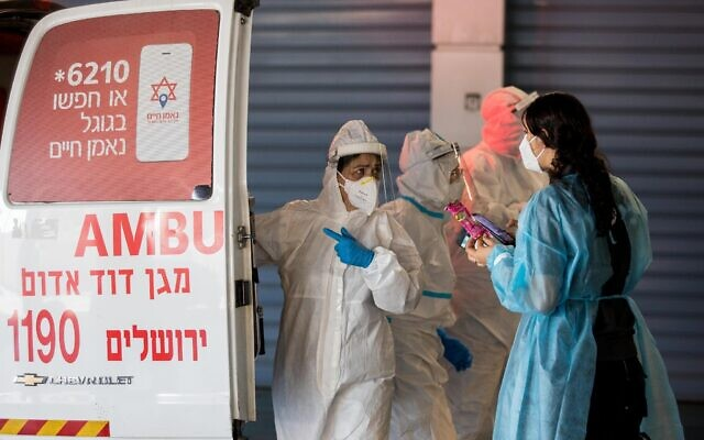 Magen David Adom workers wearing protective clothing outside the coronavirus unit at Shaare Zedek hospital in Jerusalem on September 13, 2020. (Nati Shohat/Flash90)