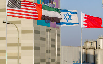 The flags of the U.S., United Arab Emirates, Israel and Bahrain seen on the side of a road in the city of Netanya, September 14, 2020. (Flash90)