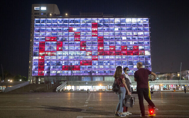 "The Tel Aviv municipality building is lit up with the word ""Peace"", in Hebrew, Arabic and English. September 15, 2020. (Miriam Alster/Flash90)"