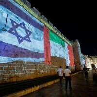 The flags of the US, United Arab Emirates, Israel and Bahrain are screened on the walls of Jerusalem's Old City, on September 15, 2020. (Yonatan Sindel/Flash90)