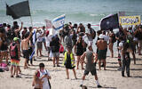 Israelis protest against the nationwide lockdown and Prime Minister Benjamin Netanyahu on the beach in Tel Aviv, September 19, 2020 (Miriam Alster/Flash90)